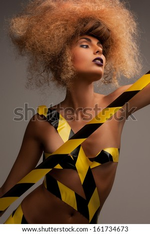 beauty and glamour concept - woman with long curly hair - stock photo