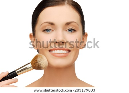 beauty and make-up concept - woman applying powder foundation with brush - stock photo