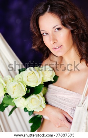 Beauty and sexy of young pregnant woman with flowers - stock photo