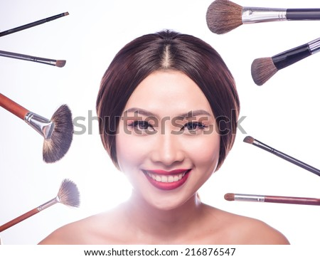 Beauty Asian Woman Portrait. Professional Makeup for Brunette with Brown eyes - Red Lipstick, Smoky Eyes. Beautiful Fashion Model Girl. Perfect Skin. Looking at camera studio shot. Isolated on White - stock photo