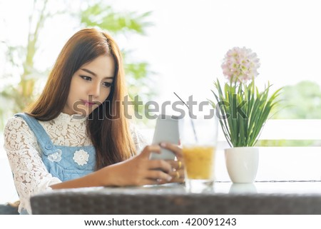 beauty asian woman sitting in coffee shop. - stock photo