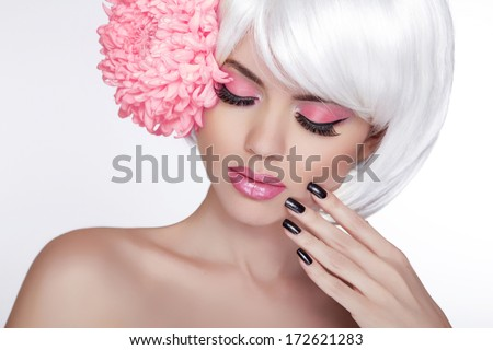 Beauty Blond Female Portrait with lilac flower. Beautiful Spa Woman Touching her Face. Makeup and manicured nails. Perfect Fresh Skin. Isolated on white background - stock photo