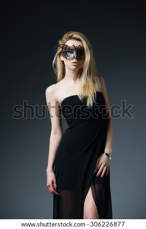 Beauty blonde model girl with carnival mask - stock photo