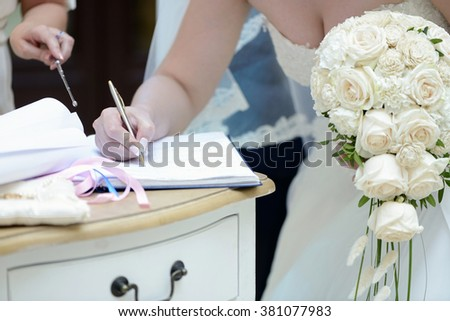 Beauty bride and handsome groom are registering the marriage. Wedding couple is marrying. Beautiful model girl in white dress and in lace veil. Man in suit. Female and male portrait. Cute lady and guy - stock photo