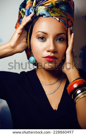 beauty bright african woman with creative make up, shawl on head like cubian  closeup - stock photo