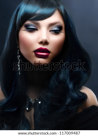 Beauty Brunette Portrait. Beautiful Woman With Black Hair and Holiday Professional Makeup. - stock photo