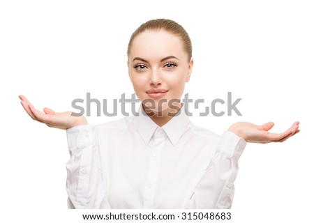 Beauty business woman portrait. Proposing a product. Beautiful girl showing empty copy space on the open hand palm for text. Gestures for advertisement. Isolated. Lady in white blouse classic - stock photo