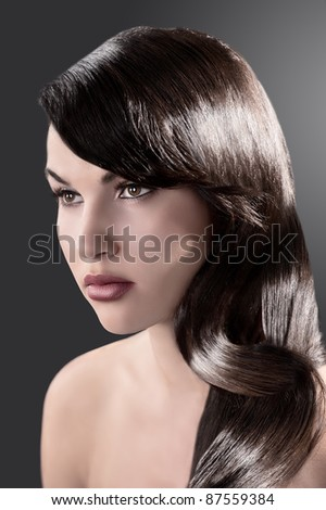 beauty close up portrait of a long haired brunette with very shiny hair - stock photo