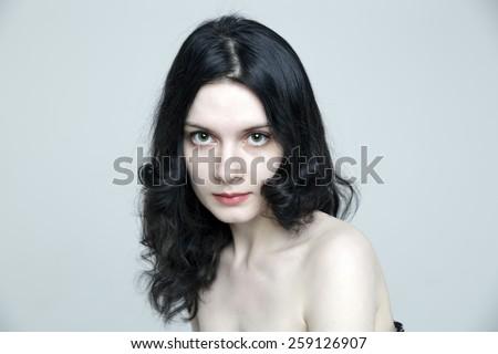 Beauty close-up portrait of lovely sensual Caucasian brunette woman model posing in studio. - stock photo