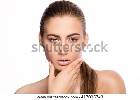 Beauty closeup portrait of young attractive woman with delicate makeup. Studio shot. White background. - stock photo