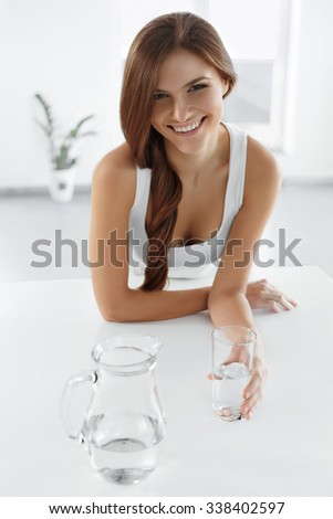 Beauty, Diet Concept. Happy Smiling Woman Drinking Fresh Crystal Clear Water From A Glass. Healthcare. Healthy Lifestyle And Eating. Health, Dieting, Fitness Concept. Drinks - stock photo