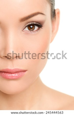 Beauty face closeup - Asian woman eye makeup concept with mascara smokey eyeshadow and eyeliner - stock photo