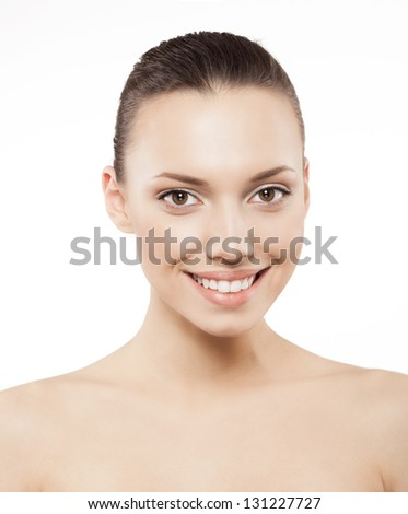 Beauty face of happy woman with clean fresh skin - isolated - stock photo
