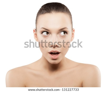 Beauty face of surprised woman with clean fresh skin - isolated - stock photo