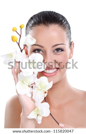 Beauty face of the young beautiful woman with white orchid - stock photo