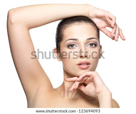 Beauty face of young woman. Skin care concept. Closeup portrait isolated on white. - stock photo