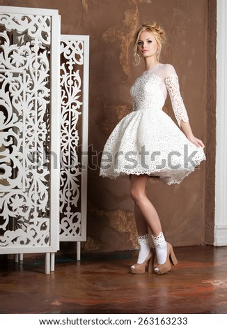 beauty, fashion and happy people concept - young woman in white dress and high heels - stock photo