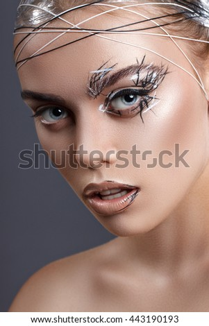 Beauty fashion close-up portrait. Girl with creative professional make-up. Beautiful blue eyes, black and white accessories - stock photo