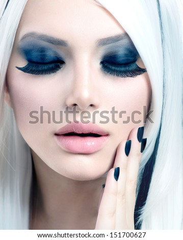 Beauty Fashion Girl black and white style. Smoky Eyes Make up, False Eyelashes and Long White Hair with Black Stripes. Smokey Eyes Makeup. Black Nails. High Key Portrait. Winter Holiday Makeover - stock photo