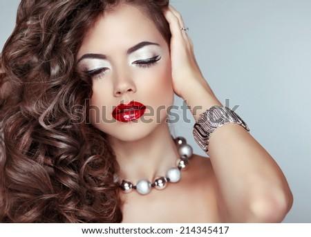 Beauty fashion girl. Long wavy hair. Red lips. Eye Makeup. Jewelry. - stock photo