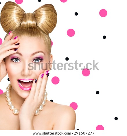 Beauty fashion happy surprised model girl with funny bow hairstyle, pink nail art and makeup isolated on white background with polka dots. Laughing retro styled young woman. Emotions - stock photo