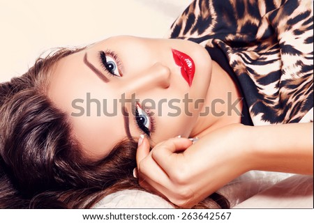 Beauty Fashion Model Girl Closeup Portrait. Young Woman with Perfect Skin, Blue Eyes, Long Eyelashes, Red Lips. - stock photo