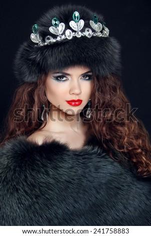 Beauty Fashion Model Girl in Fur Coat. Diamond jewelry. Beautiful Luxury Winter Woman in fur hat.  - stock photo