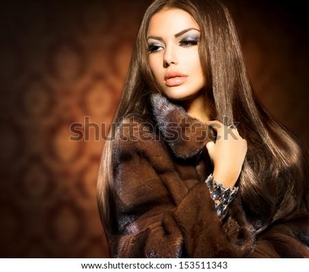Beauty Fashion Model Girl in Mink Fur Coat. Beautiful Woman in Luxury Brown Fur Jacket . Winter Fashion - stock photo