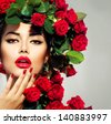 Beauty Fashion Model Girl Portrait with Red Roses Hairstyle. Red Lips and Nails. Beautiful Luxury Makeup and Hair and Manicure Vogue Style - stock photo