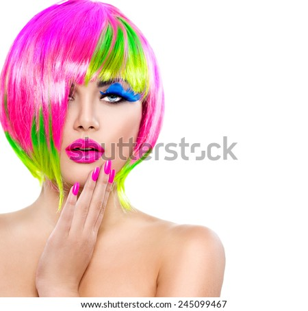 Beauty Fashion Model Girl with Colorful Dyed Hair, pink nails. Haircut with fringe. Colourful short Hair. Portrait of Beautiful Girl with Dyed Hair, professional hair Coloring. Colouring hair  - stock photo