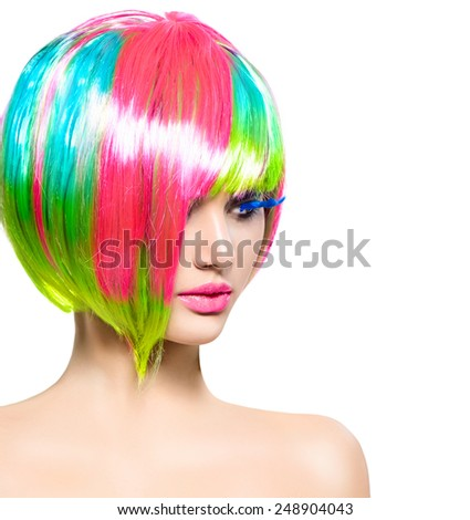 Beauty Fashion Model Girl with Colorful Dyed Hair. Short Bob Haircut with fringe. Colourful short Hair. Portrait of a Beautiful Girl with Dyed Hair, professional hair Coloring. Colouring hair  - stock photo