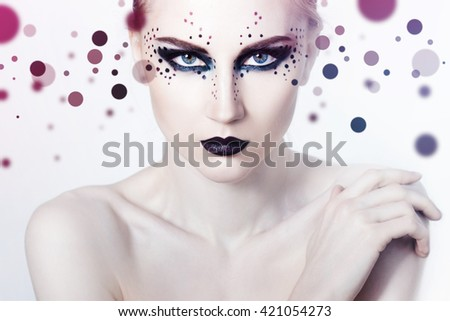 Beauty Fashion Model Girl with smoky eyes and black lips. Dots background  - stock photo