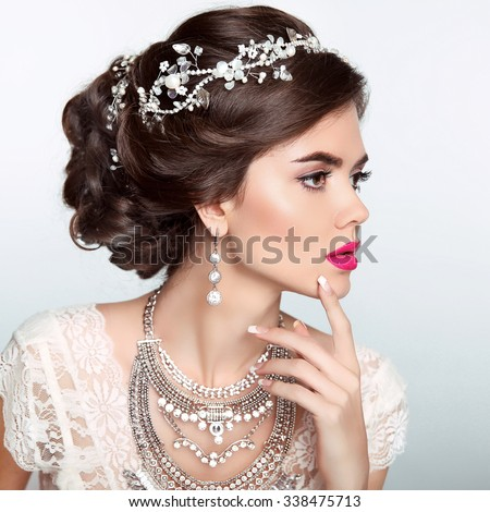 Beauty Fashion Model Girl with wedding elegant hairstyle. Beautiful bride woman with precious jewels, manicured nails. Makeup. Elegant style. - stock photo