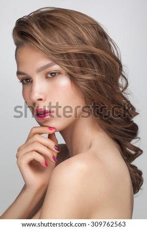 Beauty fashion portrait closeup of young attractive sensual model woman. Brilliant hazel hair, perfect skin, nude makeup with shiny lip gloss. - stock photo