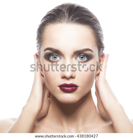 Beauty fashion portrait of caucasian brunette woman wet wet red lipstick and arms touching face. Isolated on white background.  - stock photo