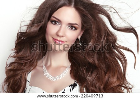 Beauty fashion smiling girl model portrait. Long healthy Wavy hair. Professional makeup. - stock photo