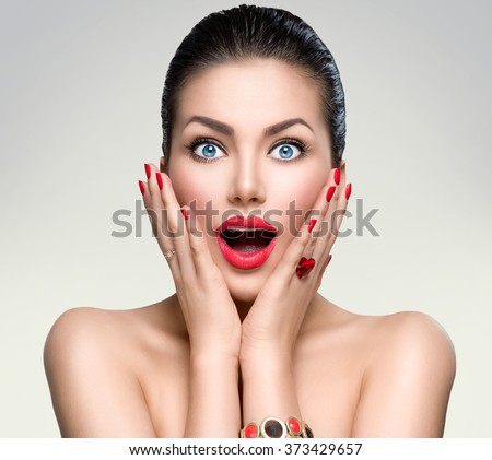 Beauty Fashion surprised Woman portrait. Beautiful model girl with perfect make up exited, screaming and open and mouth. Emotions. Isolated on a white background - stock photo