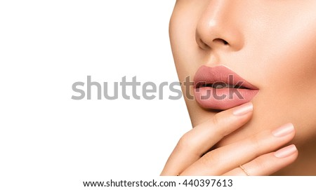 Beauty Fashion woman lips with natural Makeup and beige Nail polish. Matte lipstick and nails. Beauty girl face close up. Nude Colors. Sexy lips, Manicure, Make up. Isolated on a white background - stock photo