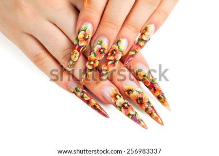 Beauty floral design nails on female hands. - stock photo