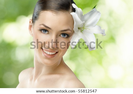beauty flower girl on the green background - stock photo
