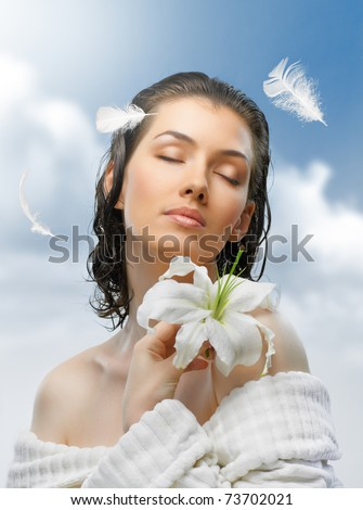 beauty flower girl on the sky background - stock photo