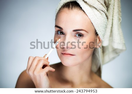 Beauty fresh model girl applying make up with pencil - stock photo