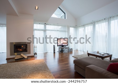 Beauty furnished drawing room with sofa and television - stock photo