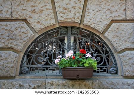 beauty geranium outdoor Flower box in window - stock photo
