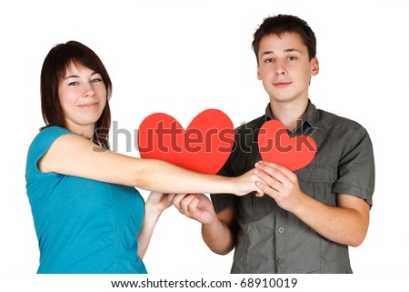 beauty girl and man holding two paper hearts, smiling and looking at camera, isolated - stock photo