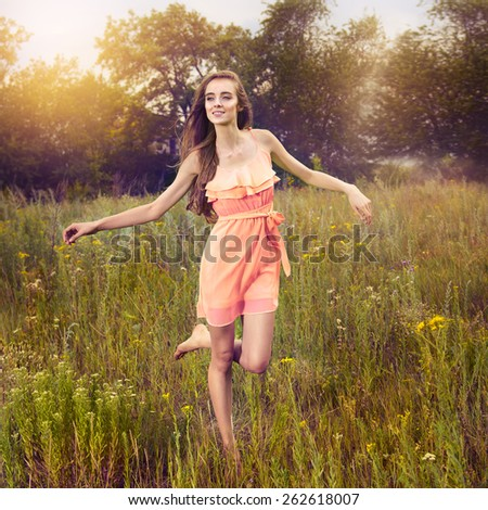 Beauty Girl Outdoors enjoying nature and run on the meadow  - stock photo