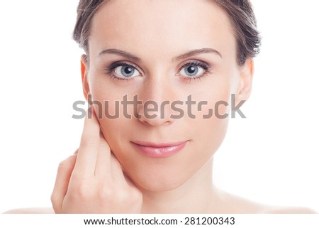 Beauty Girl Portrait. Beautiful Young Woman Touching Her Face isolated on White Background. - stock photo