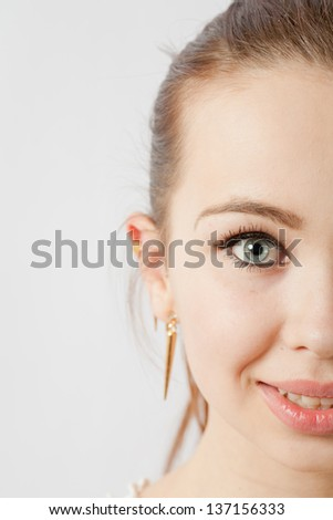 beauty girl portrait half face on white background - stock photo