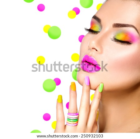 Beauty Girl Portrait with Colorful Makeup, Nail polish and ring Accessories. Colourful eyeshadows make-up. Studio Shot of Stylish Woman. Vivid Colors. Manicure, eyeshadow Rainbow Colours  - stock photo