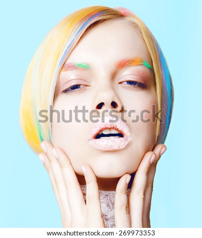 Beauty Girl Portrait with Vivid Makeup and colorful.Fashion Woman portrait close up. ?olor eyebrows. Rainbow Colors.blue background - stock photo